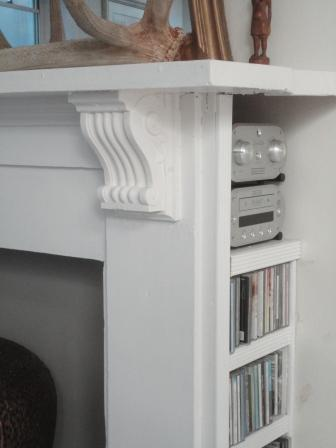 fireplace wood white mantel storage stereo CDs interiors