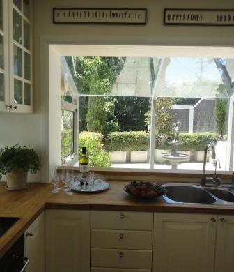 kitchen renovation after white Ikea wood benchtop window